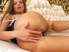 Pretty babe is drilling her shaved puss