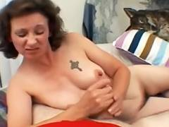 Mature lady licks and strokes cock
