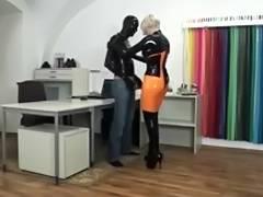 Sexy blonde mistress in latex fucks male slave
