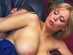 Golden Haired mommy with ideal jugs pumped on a leather daybed