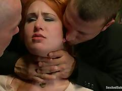 Sweet redhead girl Calico gets fucked by two men in terrific BDSM clip