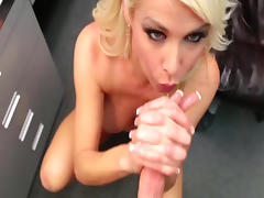 Curly blonde is giving a blowjob in the office
