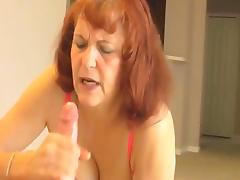 Cute mature redhead babe gives a pov blowjob