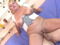 blonde mature bouncing on a hard cock