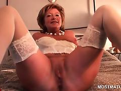 Mature sweetie in stockings dildo and finger fucks herself