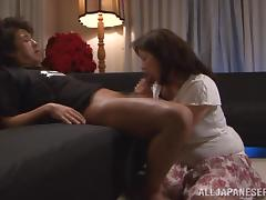 Mature Japanese woman gives a handjob in POV video tube porn video
