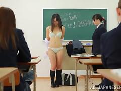Kinky Japanese student shows her snatch to her friends in a classroom