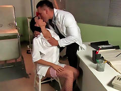 Tanned pornstar in stockings is fucking on the table