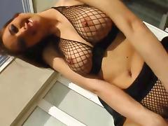 Natural busty Lara plays with her tits
