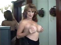 50's MILF Shows Off Her Body In Black Lingerie