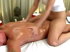 Sensual masseuse playing with dick