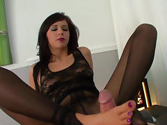 Dark-haired babe is getting cum on her feet