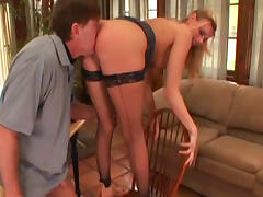 Blonde in stockings is giving a hot footjob