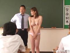 Kinky Japanese girl undresses in front of the class