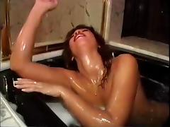 Lesbian babes have interracial Sex In a bath tub