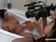 DJ gets fucked by two sexy brunettes in a bathroom