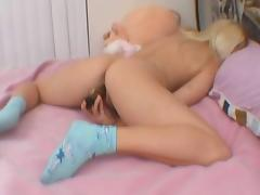 Blonde chick plays with toy