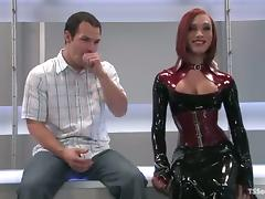 Redhead beauty in latex is a shemale that loves torturing men