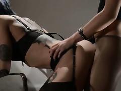 Tatto lesbs enjoying sex with strap on