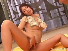 Sexy Reiko Kobayaka dances by the bar counter