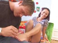 Sexy girl gives foojob cum on her feet