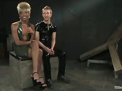 Dude in latex suit gets fucked by a filthy shemale Nyobi porn tube video