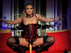 Glamorous beauty is sitting on the nice dildo