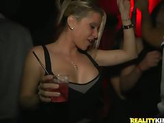 A few naughty girls share a massive cock in a VIP lounge