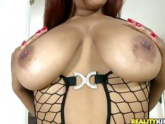 Black hottie in fishnet bodysuit rides a dick and gives a titjob