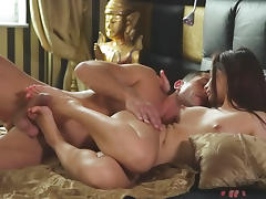 Brunette gets her nipples sucked and gives footjob