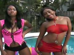Two insatiable black hussies share a cock on the poolside tube porn video