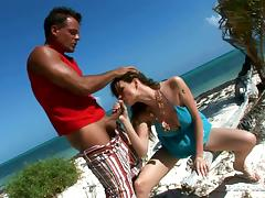 Tarra White blows and gets banged on the shore of a sea