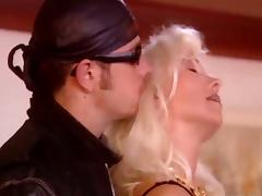 Mature blonde in stockings gets fucked by a younger dude