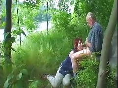 redheaded granny sucks off grandad in the woods tube porn video