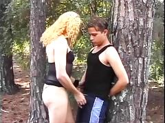 Skanky blonde tranny sucks young guys cock in the woods tube porn video