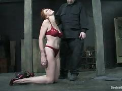 Honey is hogtied and hanged a little upper