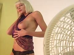 Bleached Elke shows her nice fake boobies