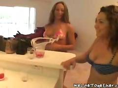 Three engaging lesbians rub each other's vags and smash them with a dildo