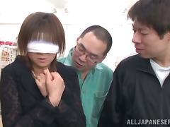 Three men fuck that sexy Asian doll Ai Komori at the super market