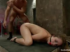 Stunning babe gets fucked rough by her master in a basement tube porn video