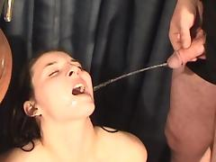 Hardcore brunette with nice face swallows piss