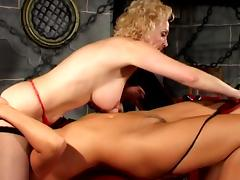 Two blondes are pissing in BDSM scene