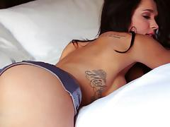 Gorgeous Brittani Jayde shows her nice boobs in a bedroom