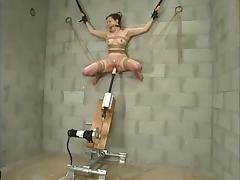 Nasty Dolores Haze gets suspended and toyed by a machine tube porn video