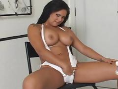 Tanned busty model gives a deep blowjob