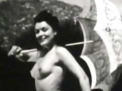 Slender brunette gets naked on the camera