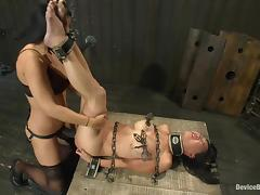 Isis Love torments Tia Ling and smashed her snatch with a strapon