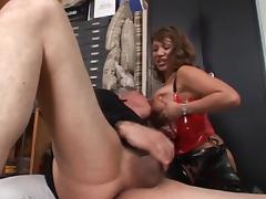 Real busty babe in latex sitting on guy's face