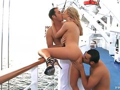 Slutty Jaelyn Fox gets pounded by two guys on a ship deck