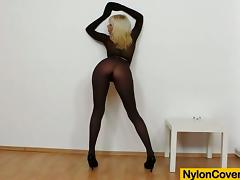 Smoking hot blond siren puts on her nylon suit and fucks herself tube porn video